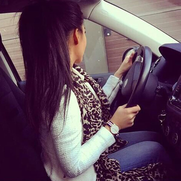Girl with jeans in car