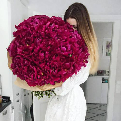 cute-girl-smelling-roses-bouquet